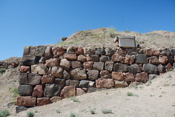 Wall in the fortress with the tablet