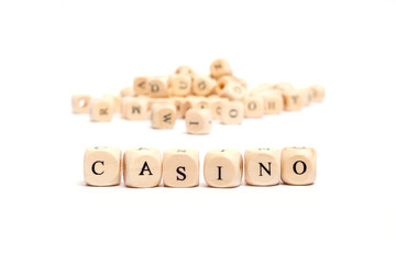 word with dice on white background- casino