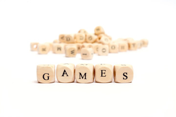 word with dice on white background- games