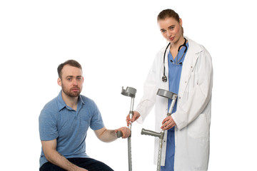Female Doctor Handing Crutches to Patient