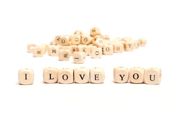 word with dice on white background- i love you