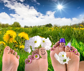 Happy together: Feet on meadow with dandelions :)