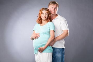 parent man and pregnant woman
