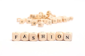 word with dice on white background- fashion