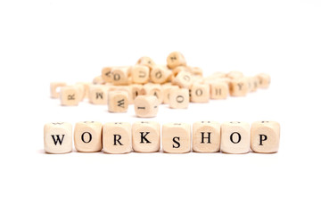 word with dice on white background- workshop