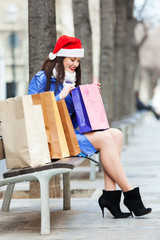 Young woman with shopping bags at street