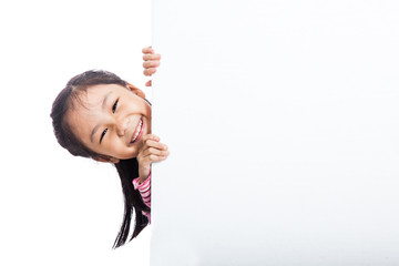 Asian little girl peeking  behind empty billboard