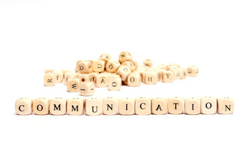 word with dice on white background- communication