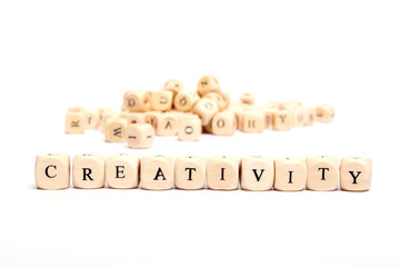 word with dice on white background- creativity