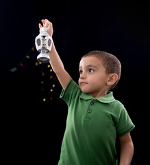 Happy Little Child with Ramadan Lantern