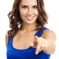 Woman pointing at something or pressing virual button