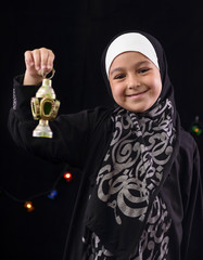 Happy Young Muslim Girl with Ramadan Lantern