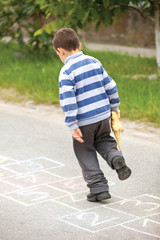 boy on the hopscotch