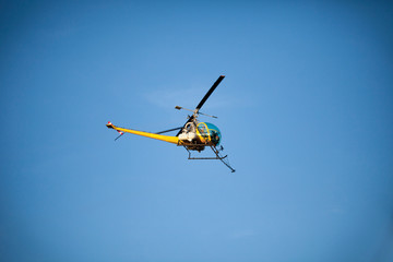 Crop sprayer duster helicopter, spraying mountains, fields and l