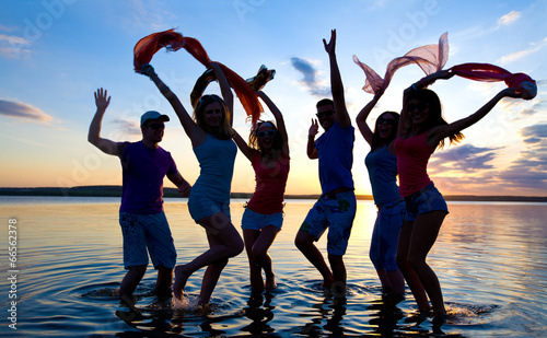 happy people  on beach - 66562378
