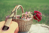 Guitar, basket and bouquet of flowers. Vintage tender background poster