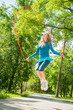 Active sporty girl jumping in park