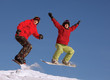 Two snowboarder jumping