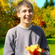 Teenager with Autumn Leafs