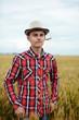 Teenage boy in a wheat field