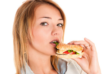 young woman eating a hamburger
