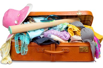 Retro suitcase, full of clothes and vacation items
