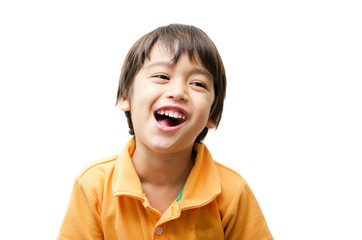 Little cute boy laughing on white background