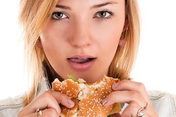 portrait woman closeup eating a hamburger
