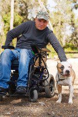 Young man in a wheelchair with his faithful dog.