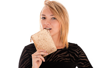 successful young woman biting purse
