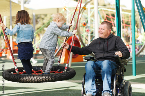 Dad play with son and daughter - 66568364