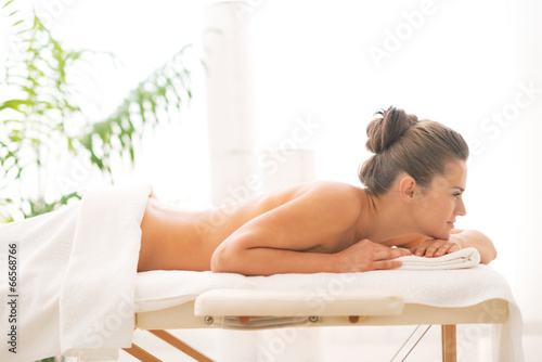 canvas print picture Relaxed young woman laying on massage table