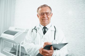 Smiling senior doctor