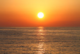 Fototapety Golden sunset with reflection on the sea