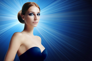 gorgeous woman with evening makeup on a blue background