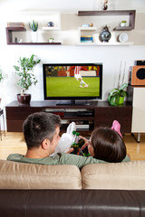 Couple watching sport