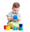 Funny little child playing with toys  isolated over white