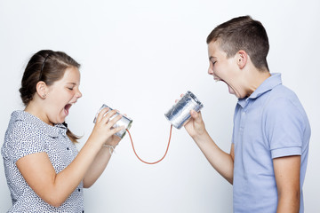 Kids screaming to a can against gray background