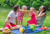 Happy family picnicking in the park and have fun