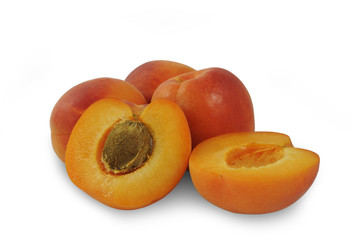 Several ripe apricots isolated on white background