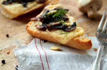 Roasted bread with mushrooms, cheese and garlic