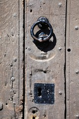 Wooden door with knocker and lock © Arena Photo UK