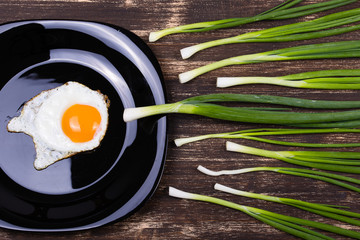 Egg , chives and black plate look like sperm competition