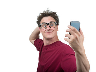 Funny man photographing himself on a smartphone