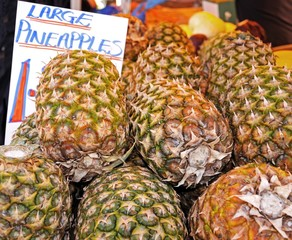 Pineapples on market stall © Arena Photo UK