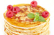 Pancakes with honey, raspberry and a mint branch