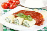 Cannelloni with spinach and ricotta under tomato sauce