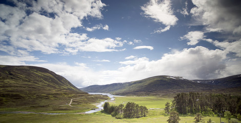 loch and mountain landscape in the cairngorm national park, scot