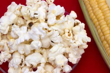 Glass bowl with popcorn and sweet corn