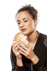 beautiful girl enjoying the scent of a sandwich